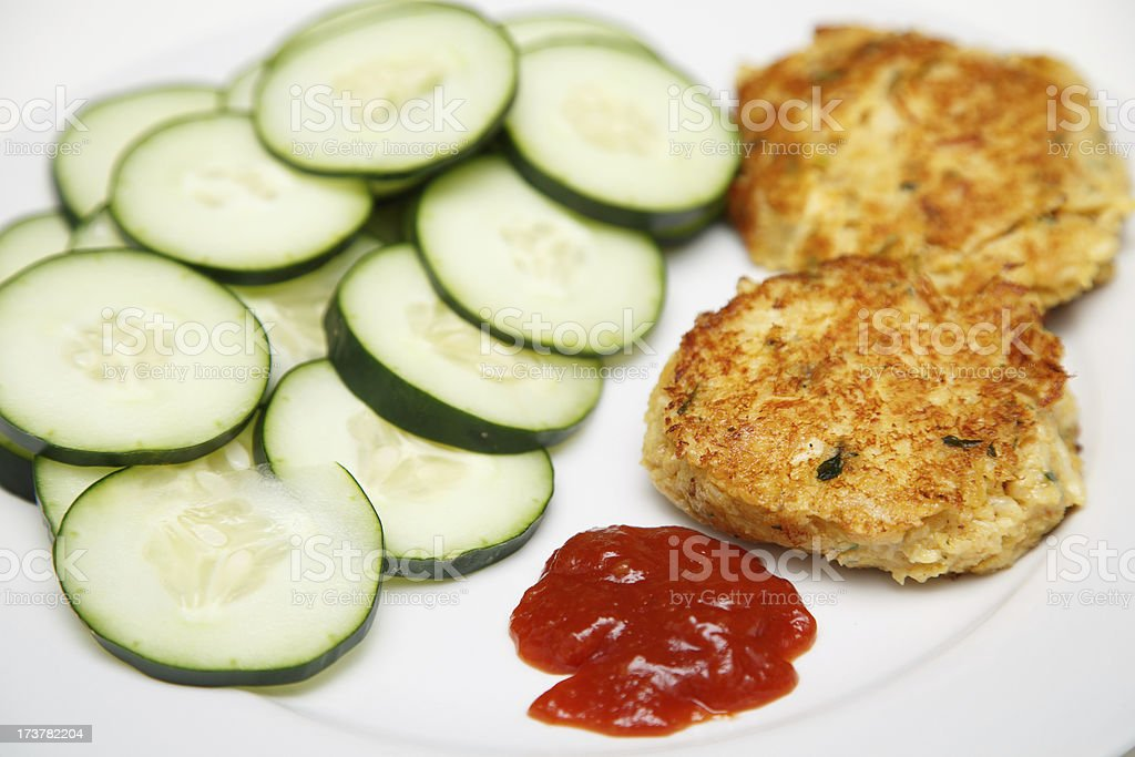 Crab Cakes and Cucumbers with Cocktail Sauce royalty-free stock photo
