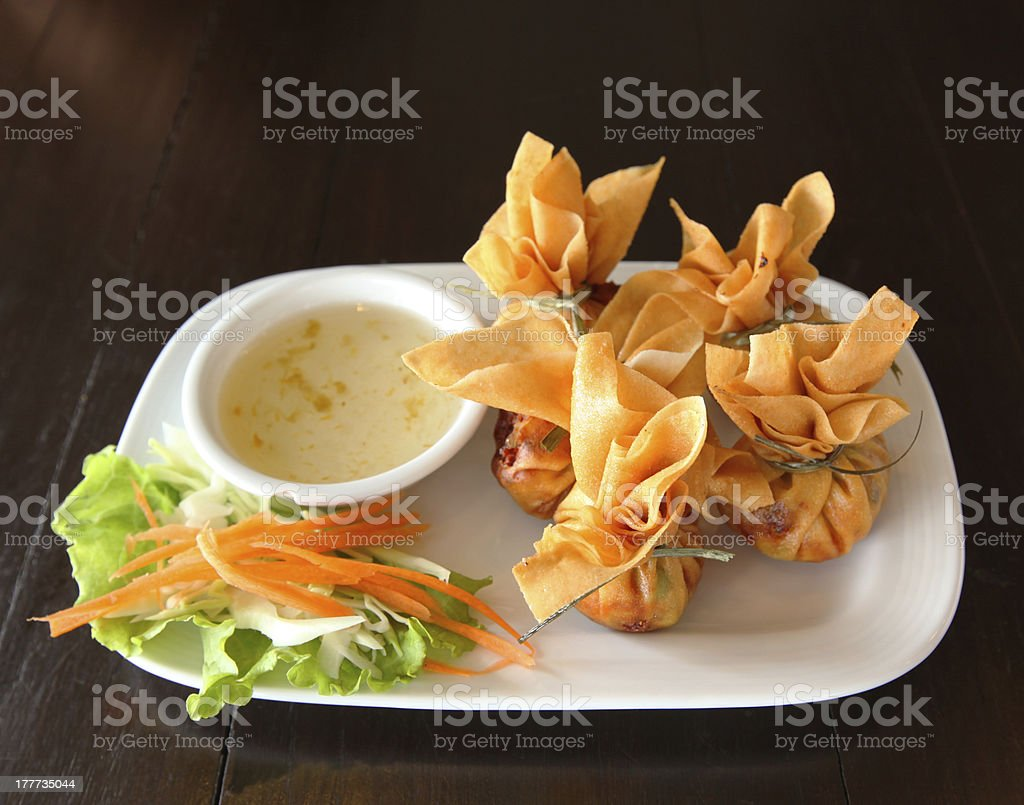 Crab rangoon with sauce royalty-free stock photo