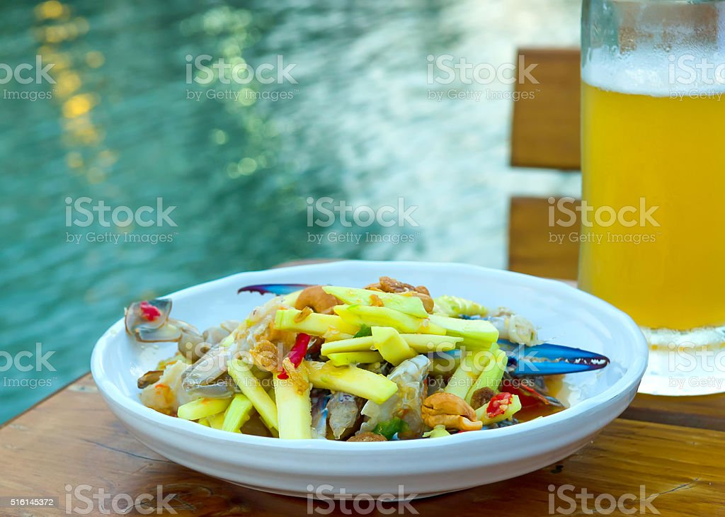 Crab salad as a snack, served with beer. stock photo