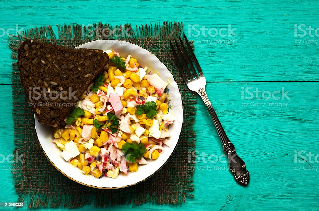 crab salad in a plate on a wooden table.Rustic style stock photo