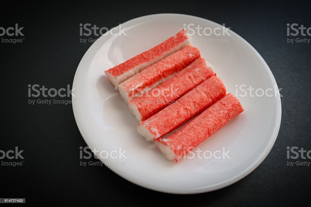 Crab stick in white plate. stock photo