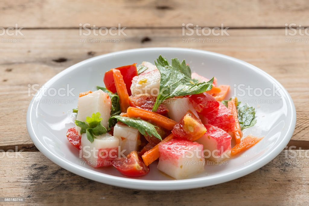 Crab stick spicy salad with vegetable. stock photo