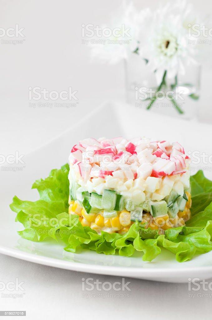 Crab sticks salad on white tablecloth stock photo
