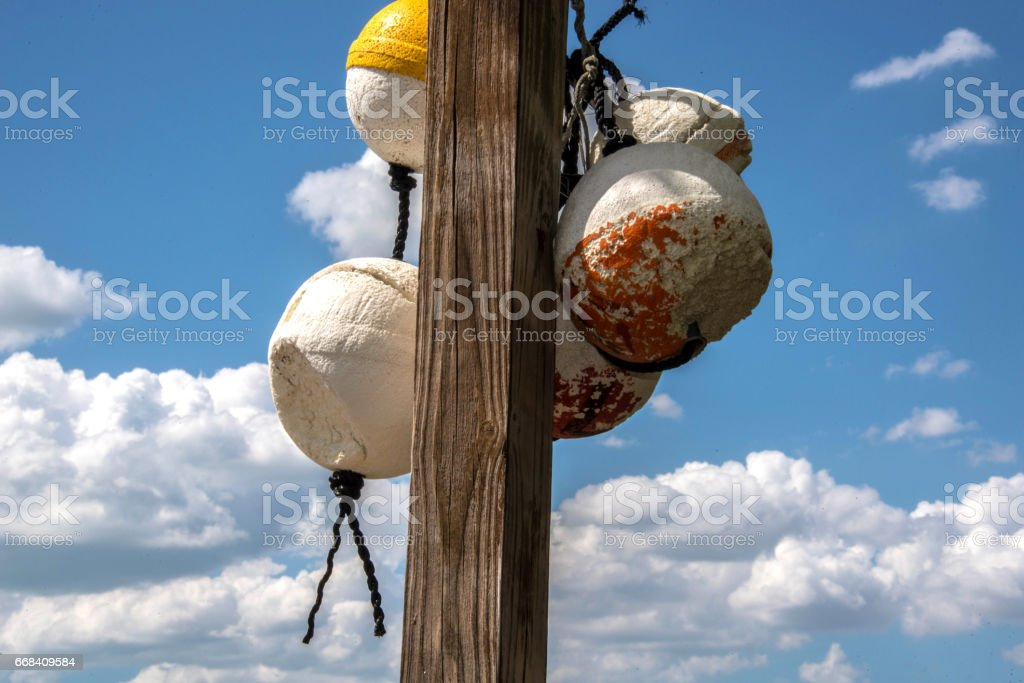 Crab trap float Blue sky white clouds background stock photo