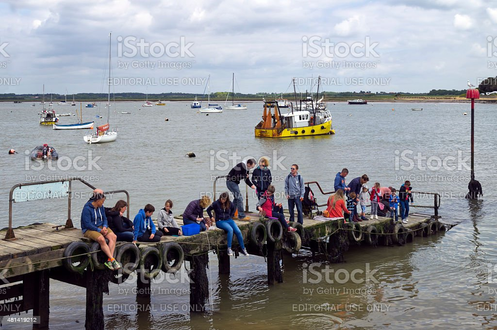 Crabbers on a jetty at Felixstowe Ferry stock photo