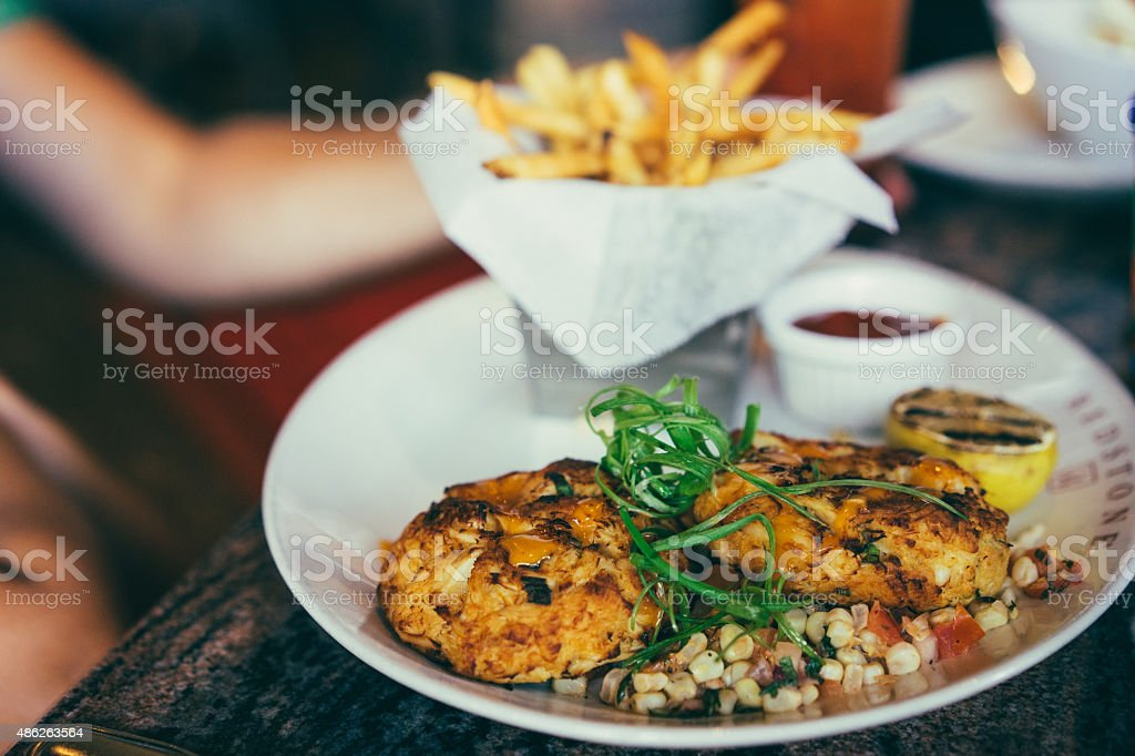Crabcakes with frensh fries stock photo