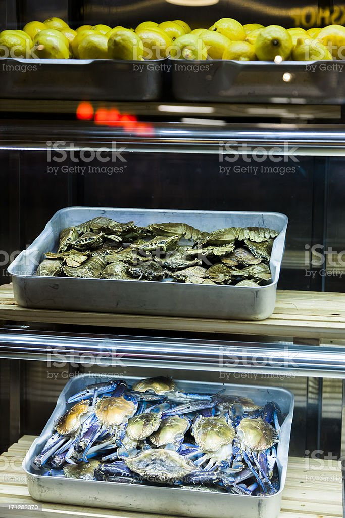 'Crabs, Lobsters and Lemons at the Seafood Market' stock photo