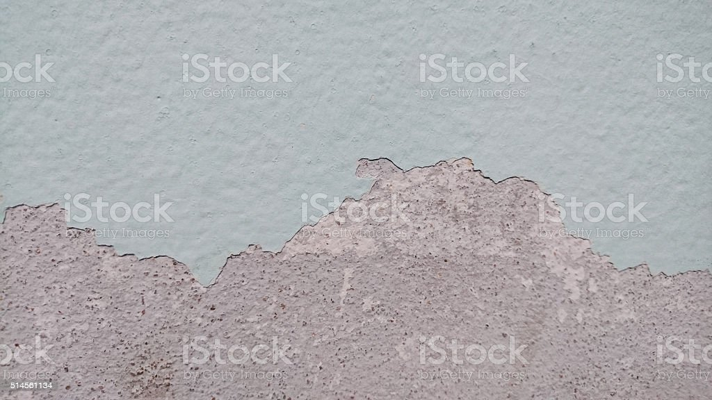 crack colour paint on wall after flood stock photo