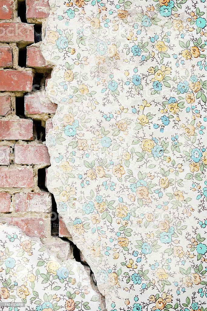 Crack In A Brick Wall With Aged Wallpaper royalty-free stock photo