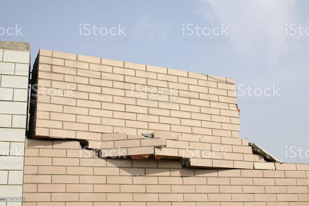 crack in tile wall stock photo