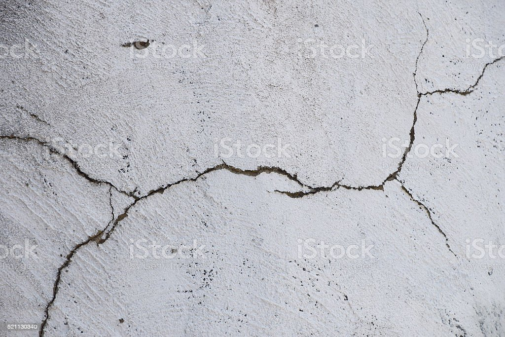 Crack in white painted concrete wall royalty-free stock photo