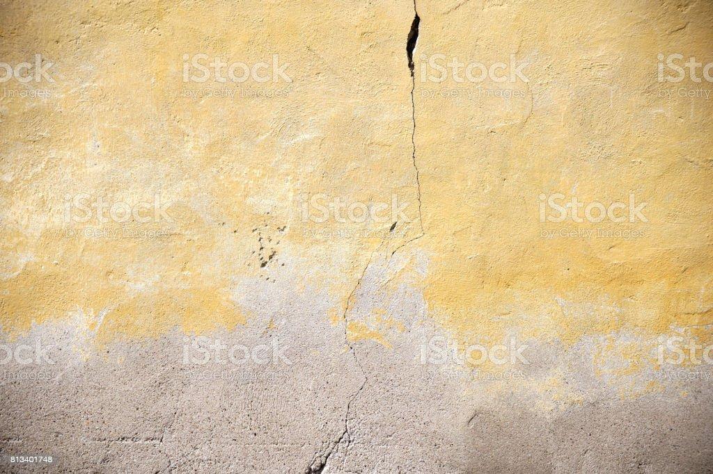 Crack in yellowed facade stock photo