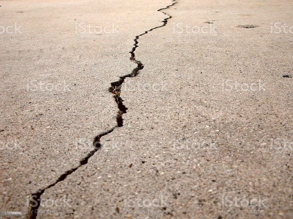 Crack line in the sidewalk close up stock photo