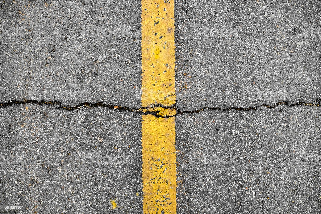 Crack on line yellow on road textured stock photo