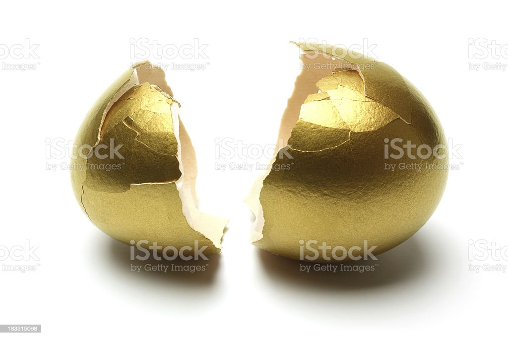Crack Opened Gold Egg on White Background stock photo