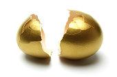 Crack Opened Gold Egg on White Background