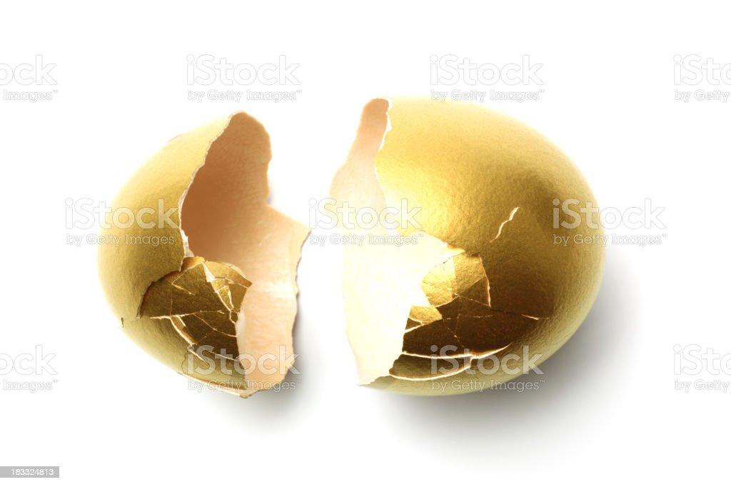 Crack Opened Gold Egg Shell on White Background stock photo