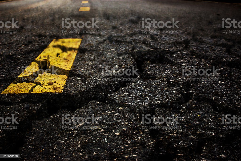 Crack textured asphalt road background. stock photo