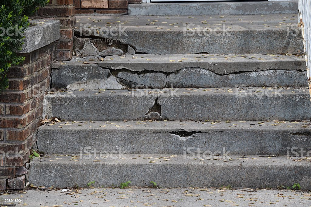 Cracked and broken cement steps stock photo