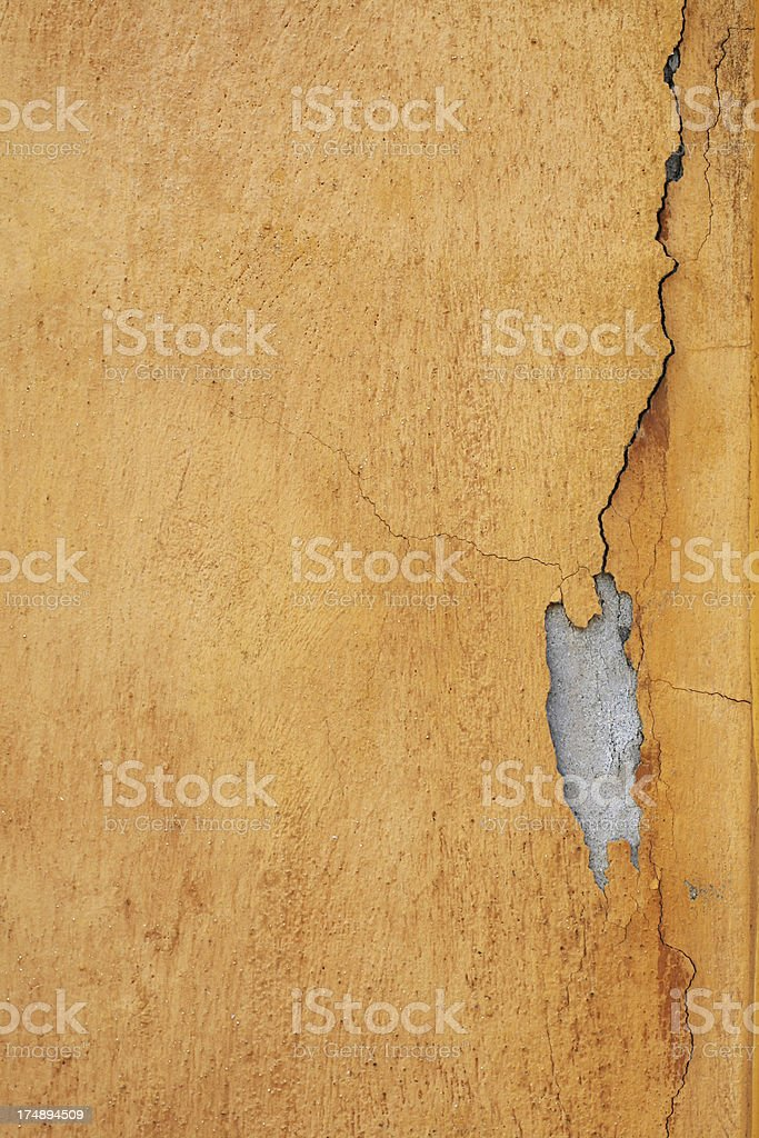 Cracked and flaked orange Roman wall, Rome Italy royalty-free stock photo