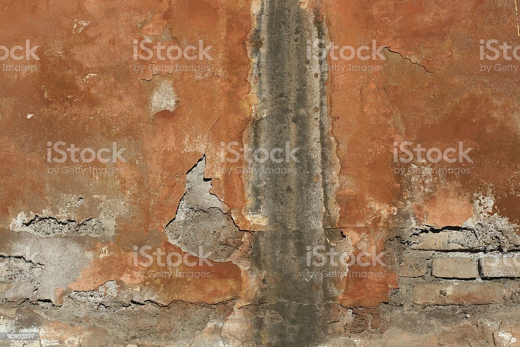 Cracked and flaked red Roman wall royalty-free stock photo