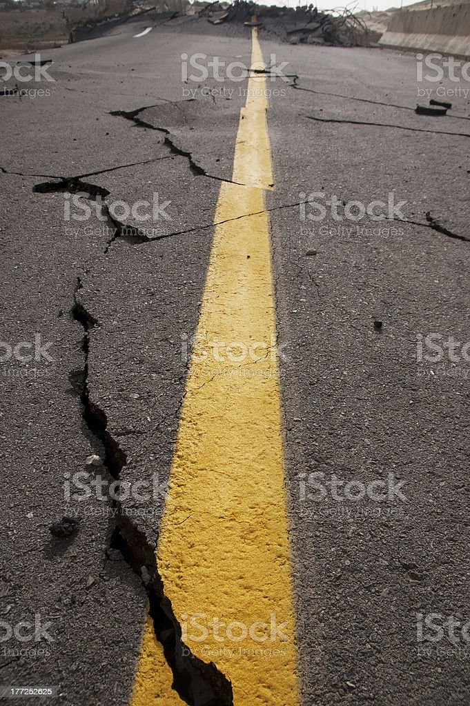 cracked asphalt after earthquake stock photo