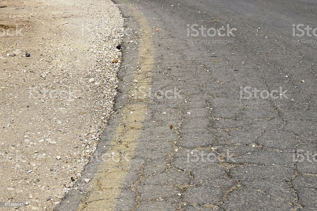 cracked asphalt stock photo
