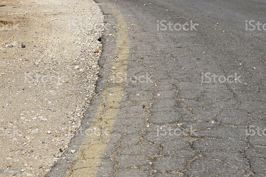 cracked asphalt stock photo