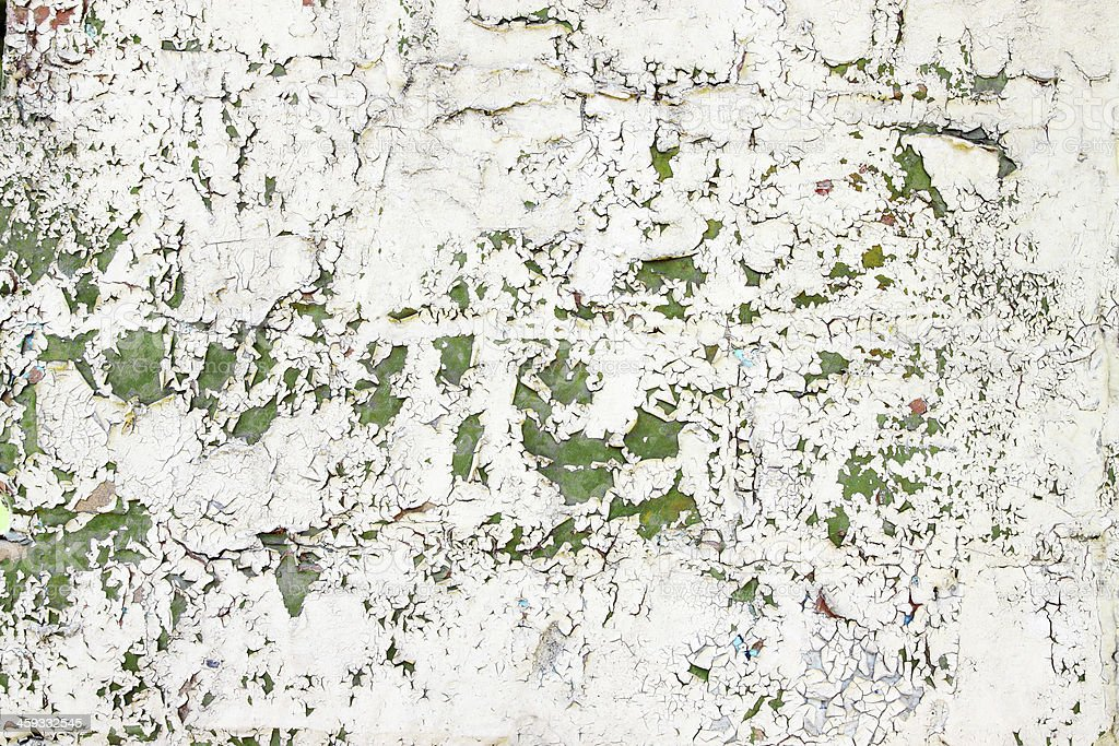 cracked beige, green paint stock photo