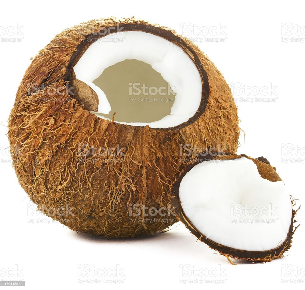 Cracked coconut on a white background. royalty-free stock photo