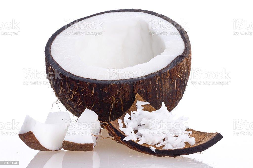 Cracked coconut on white background stock photo
