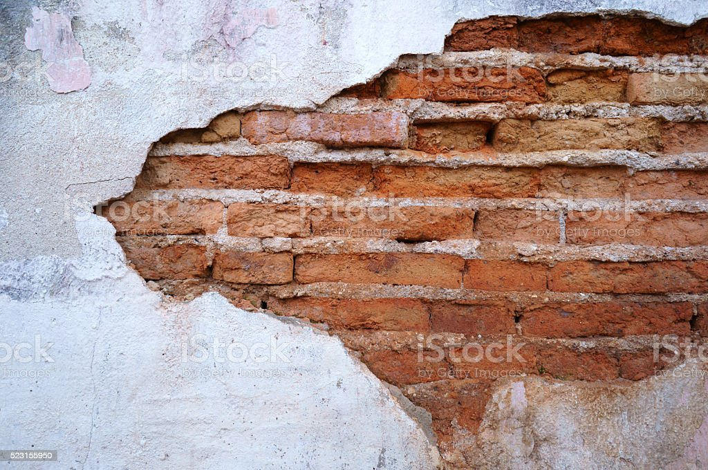 Cracked concrete brick wall background stock photo