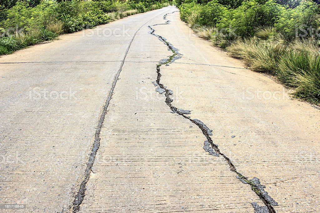 cracked concrete road after earthquake royalty-free stock photo