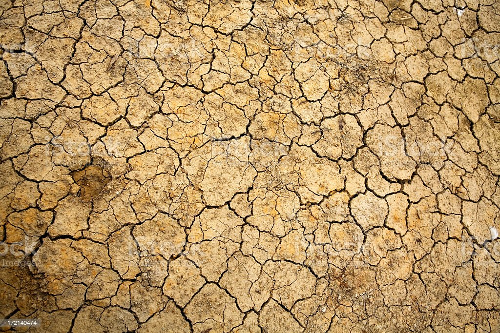Cracked dry earth showing global warming stock photo