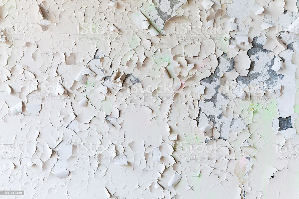 Cracked flaking paint on wall, background texture stock photo