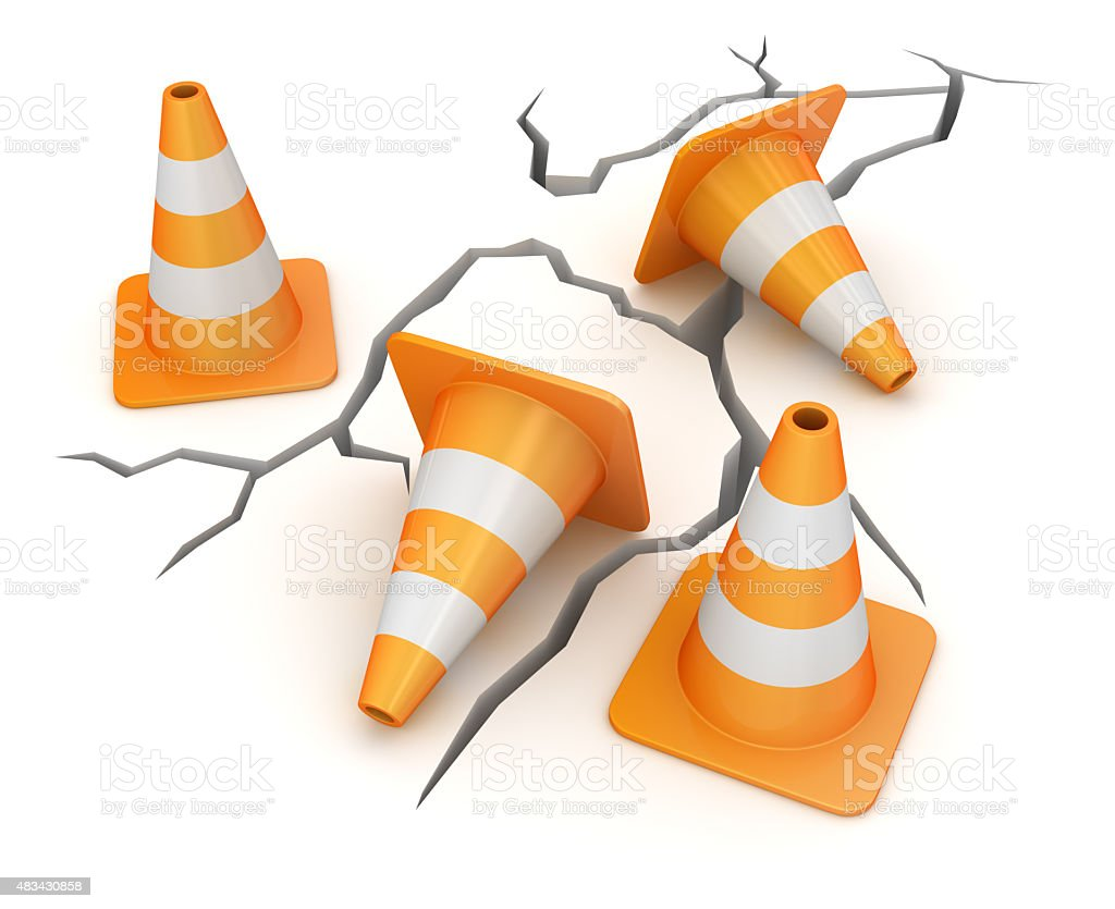 Cracked ground and traffic cone stock photo