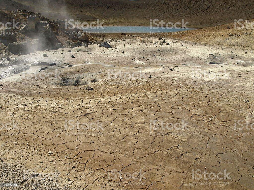 Cracked mud and blue lake stock photo