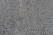 Cracked old gray cement concrete stone wall