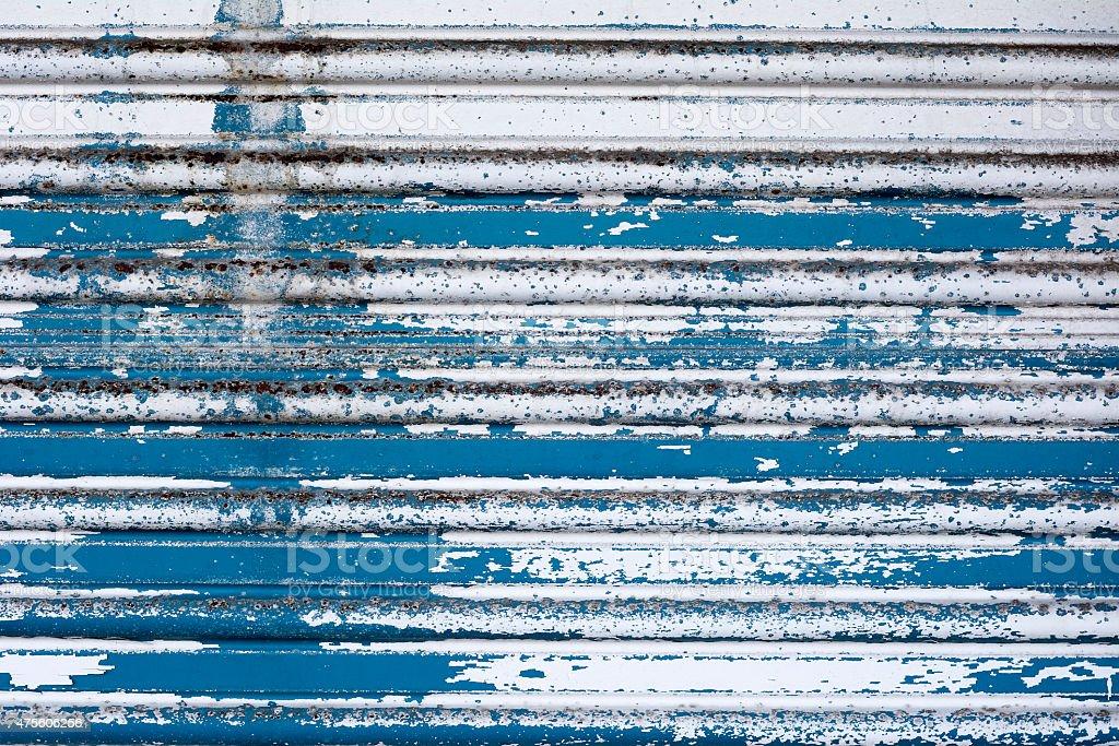 Cracked paint on a metal door stock photo