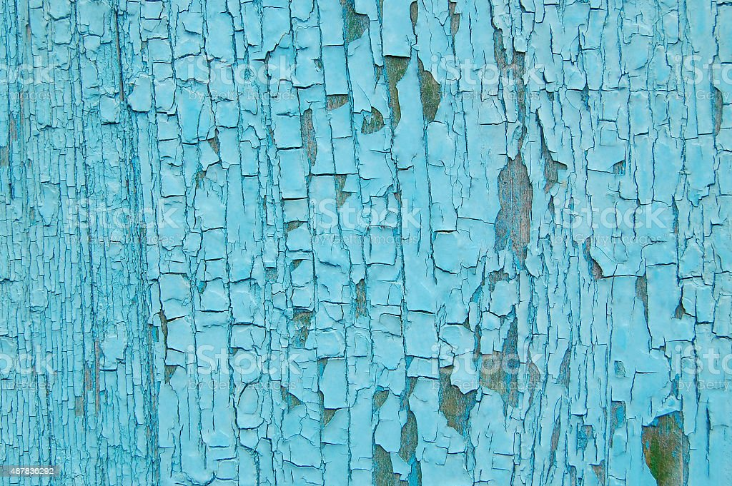 Cracked paint on a wooden wall stock photo
