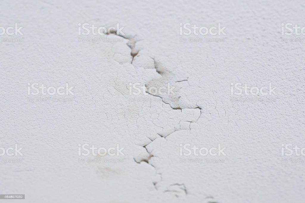 Cracked peeling layer on ceiling stock photo