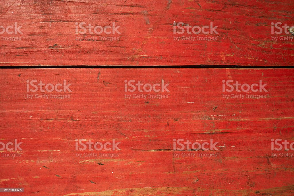 Cracked red painted planks stock photo
