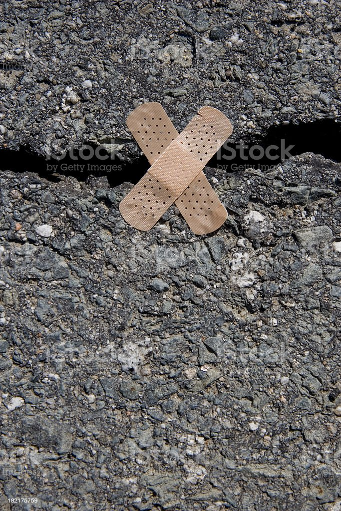 Cracked Road Bandaid royalty-free stock photo