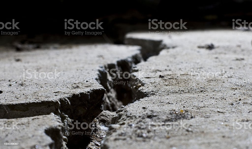 cracked road concrete close up stock photo