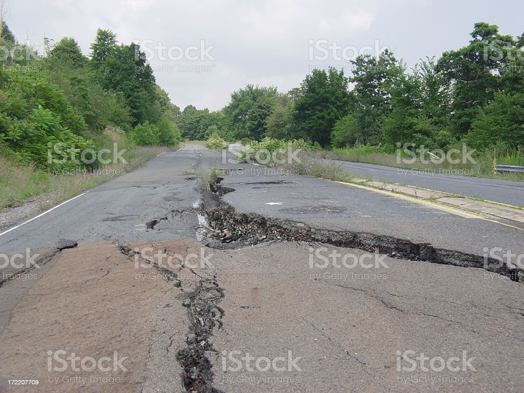 Cracked road stock photo