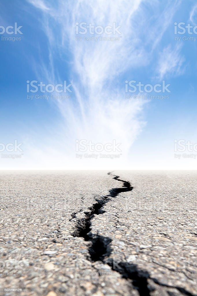 cracked road with cloud background stock photo
