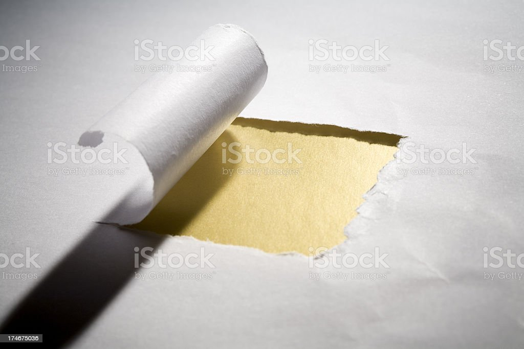 Cracked sheet of paper on gold background royalty-free stock photo