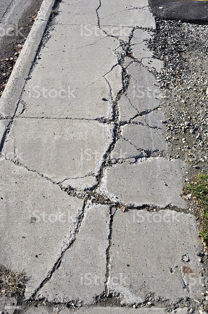 Cracked Sidewalk in Urban Area royalty-free stock photo