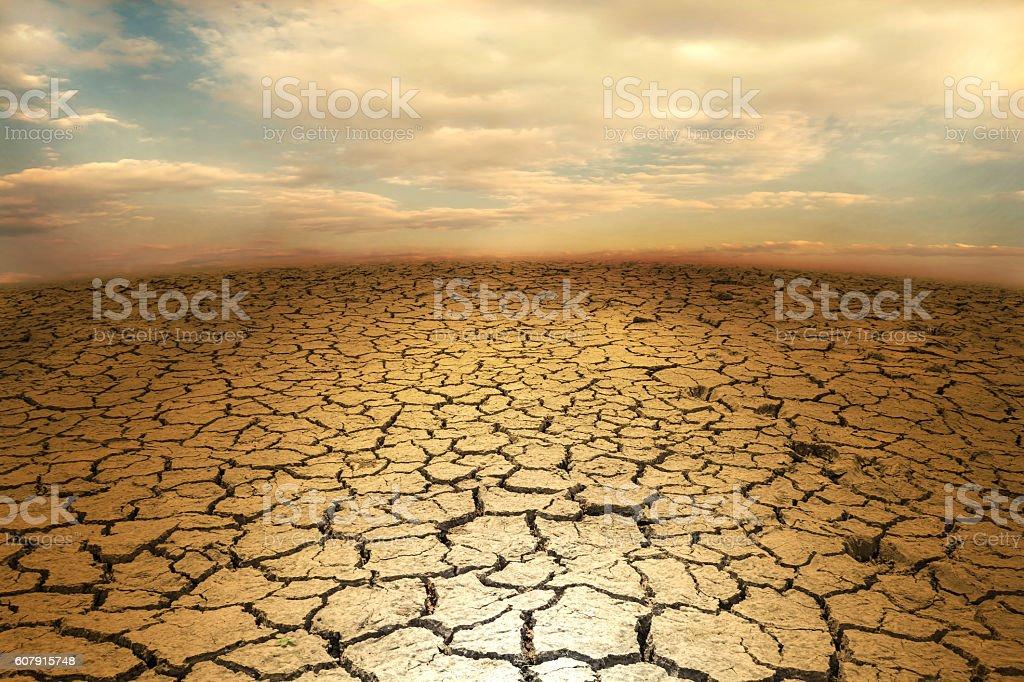 Cracked soil earth desert terrain with sky stock photo