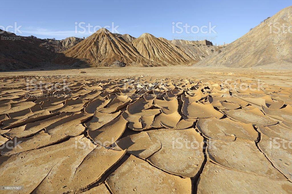 Cracked soil in the desert stock photo